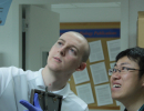 John and Bing examining a Western blot